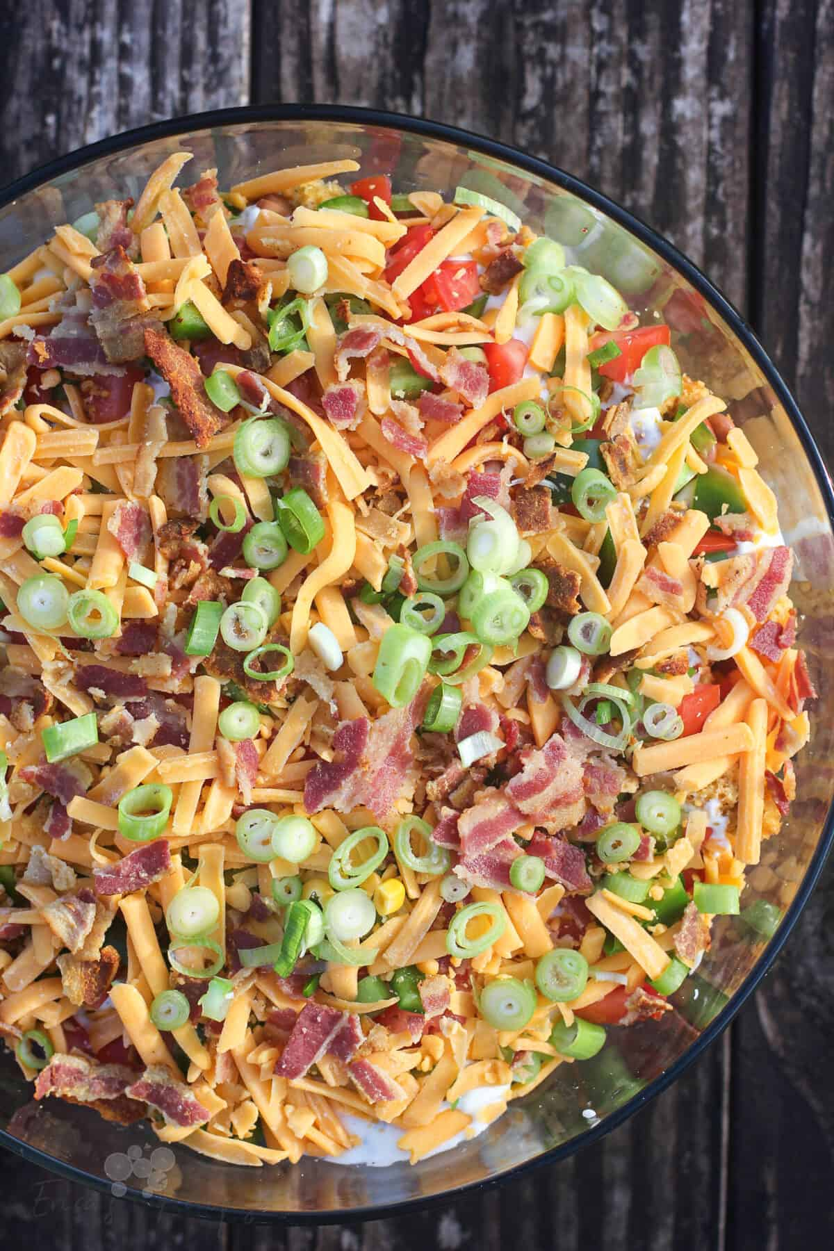 top down view into glass bowl with jalapeno cheddar cornbread salad