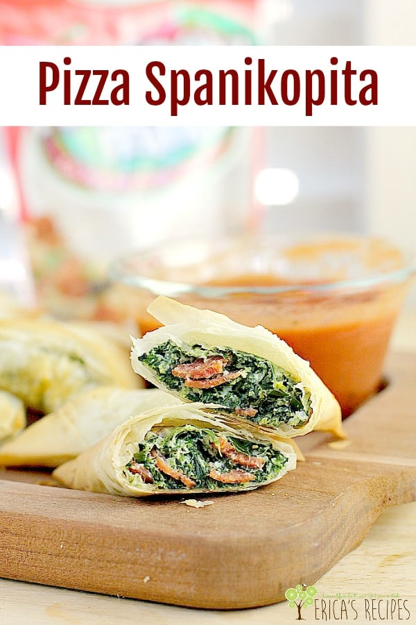 Bits of pepperoni in a creamy, garlicky spinach filling, wrapped a flaky fillo crust. With warm marinara for dunking, this Pizza Spanikopita appetizer twist on the classic spanakopita recipe will wow them all. #appetizer #partyfood #food #recipe #spanakopita #spanikopita #pizza #funfood #mediterraneanfood #greekfood