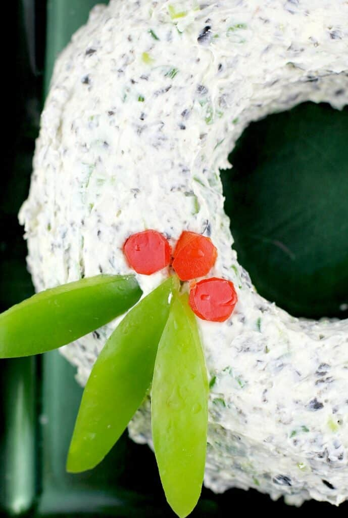 close in side view of the wreath to show the bell pepper garnish
