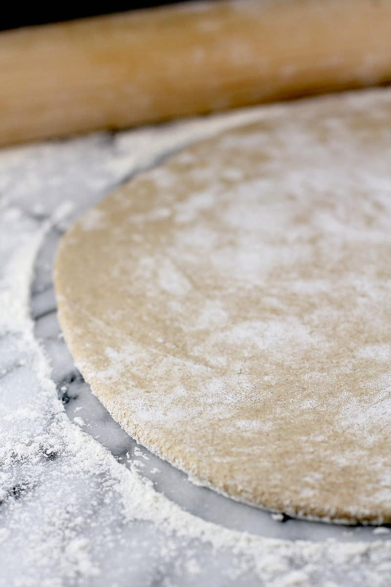the dough rolled out with on a marble surface
