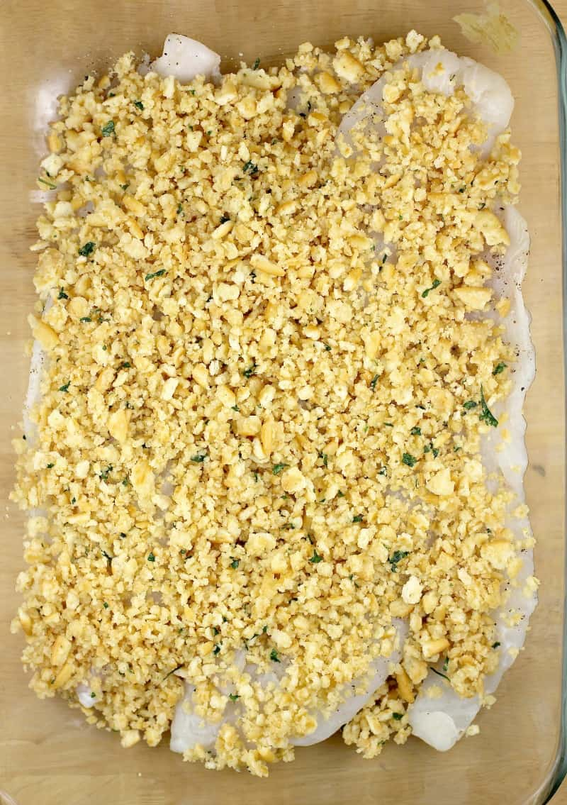 topping on fish assembled in bake dish