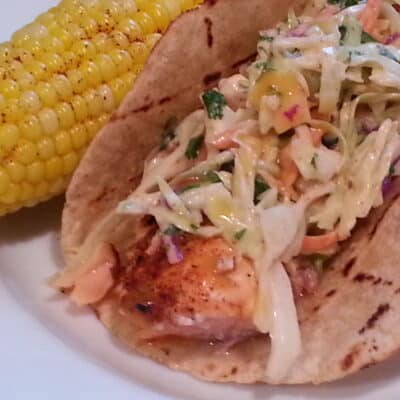 Salmon Tacos with Chipotle Cole Slaw and Orange-Jalapeno Sauce