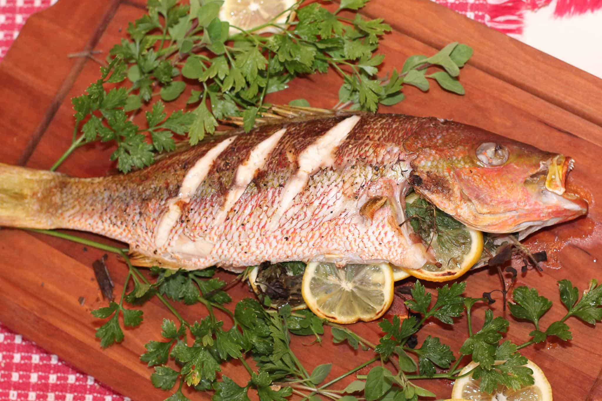 Grilled Whole Snapper with Light Lemon-Herb Cream Sauce