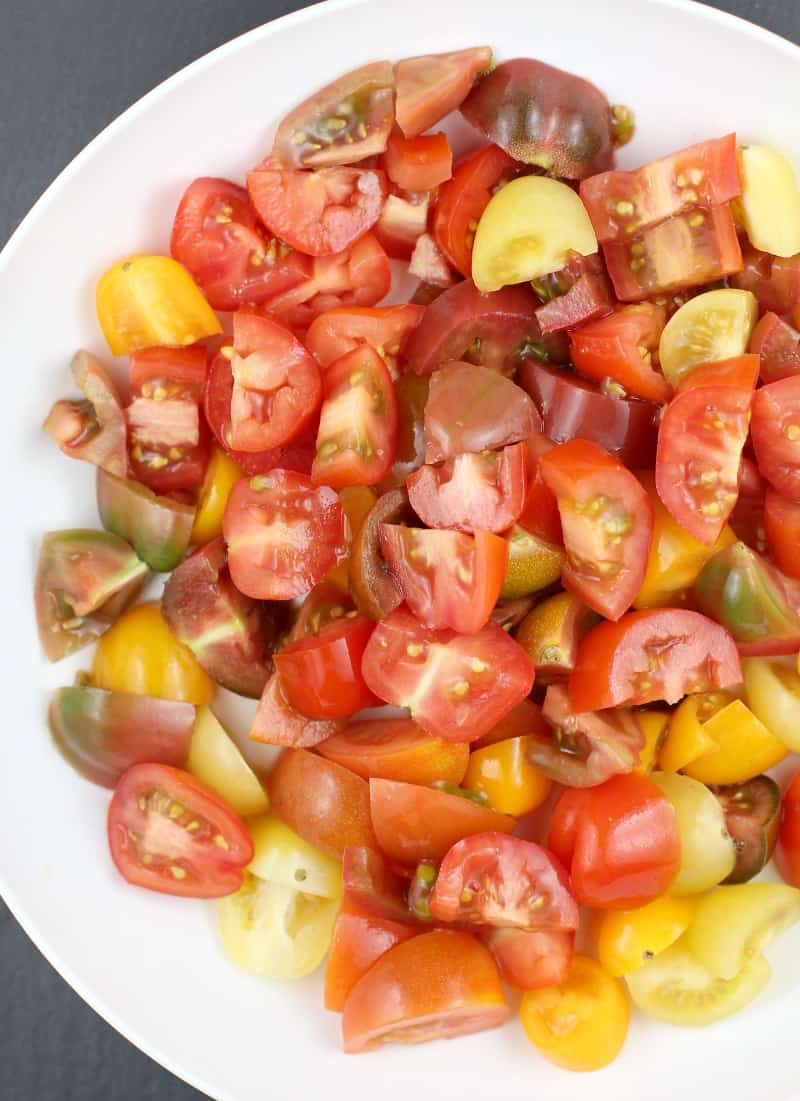 medley of chopped heirloom tomatoes on a white plate