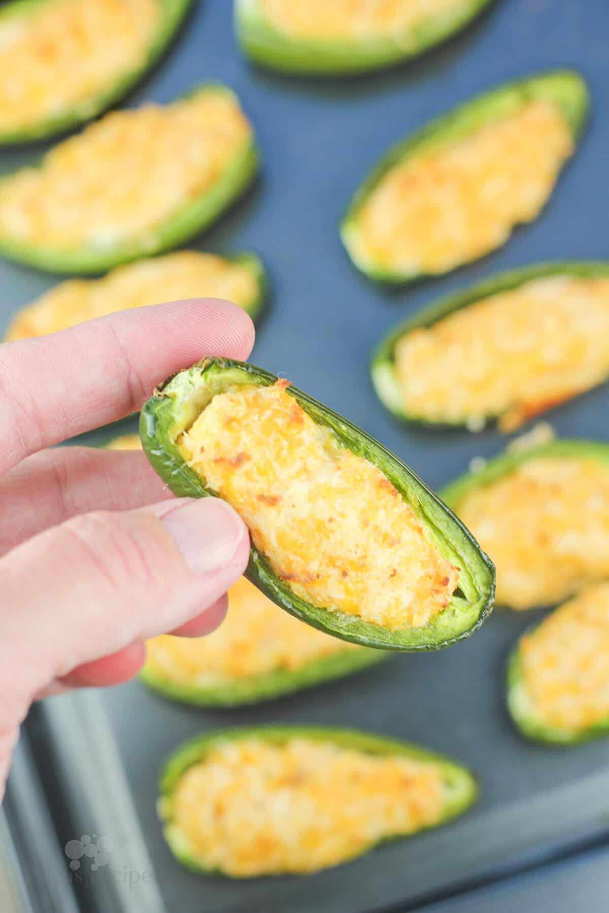 hand holding a cooked jalapeno popper