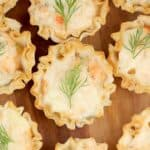 top down view of a mini smoked salmon tart with dill garnish