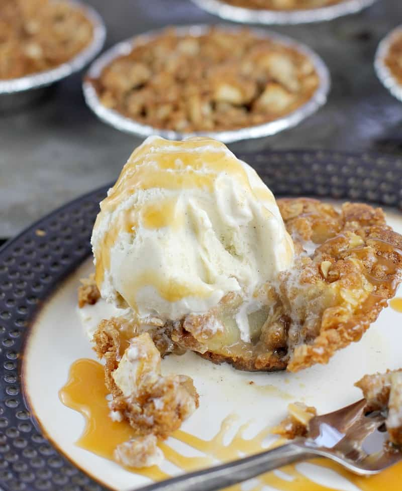 apple crisp pie on a plate with a bite removed