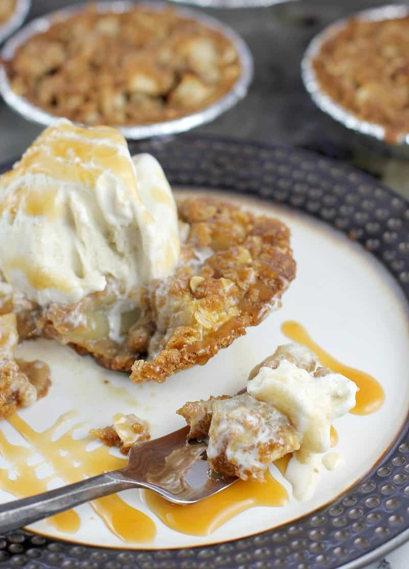 fork on a plate with apple crisp and ice cream