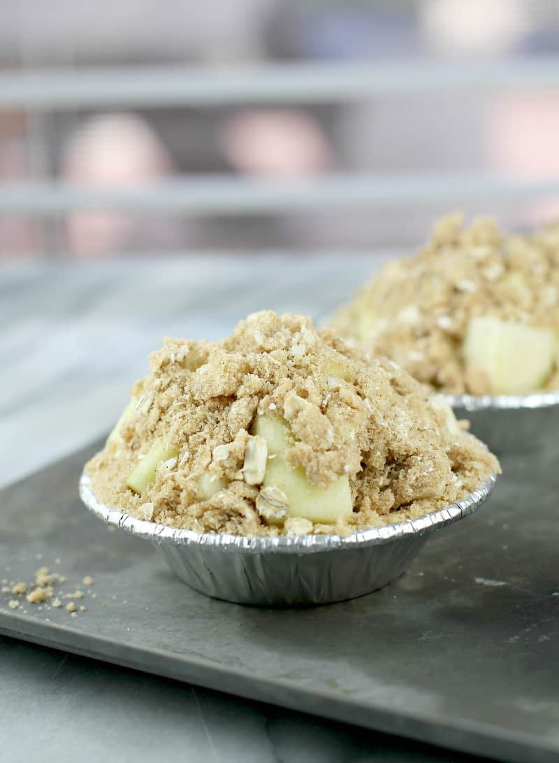 mini pie filled with apple and topped with streusel