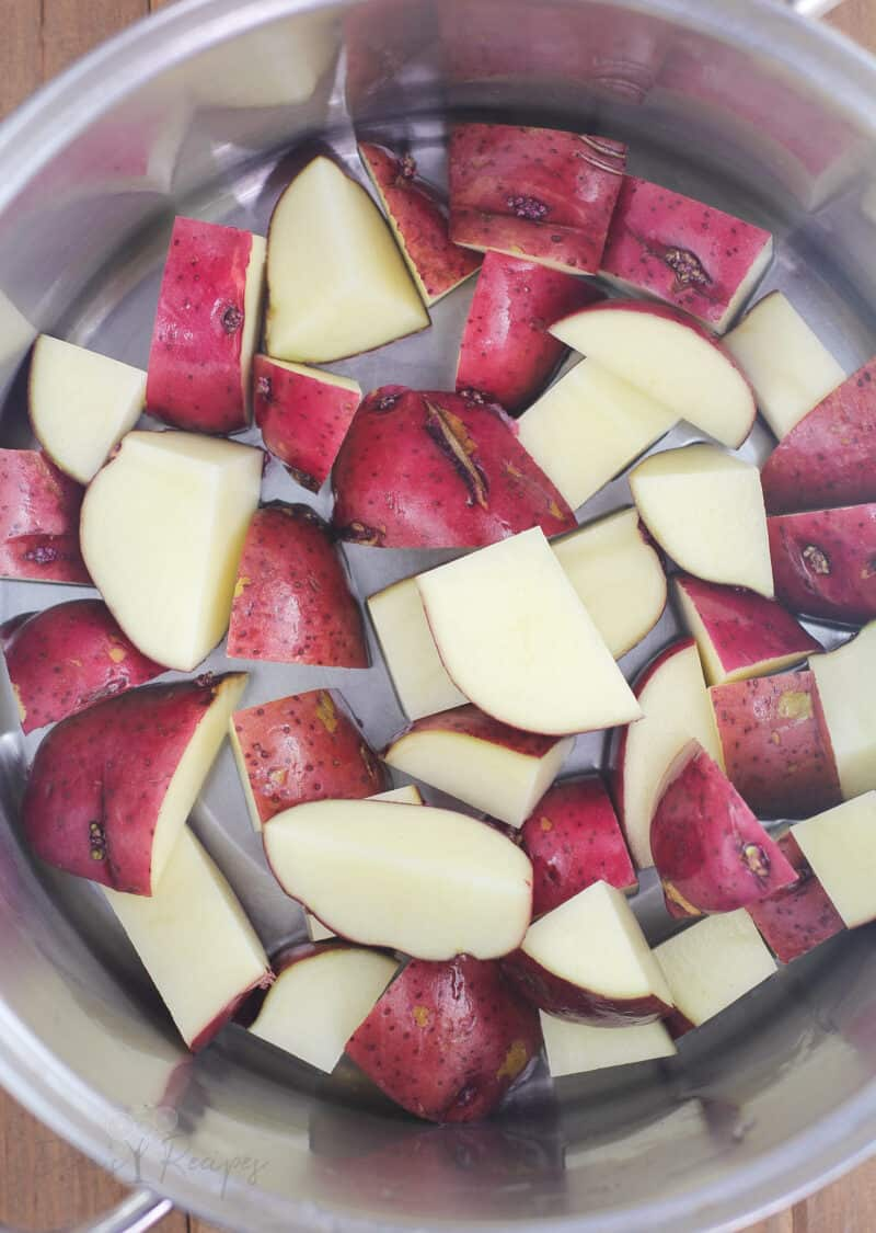 chopped red potatoes in metal pot