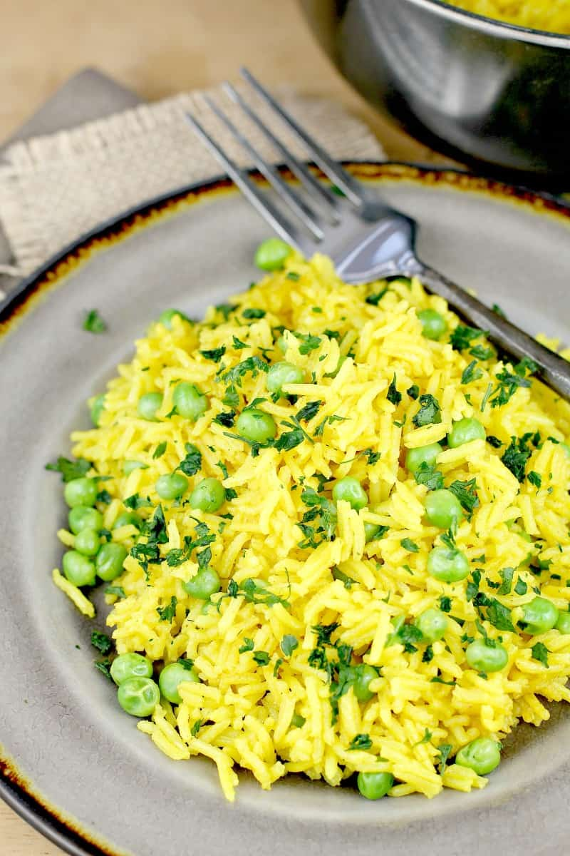 yellow rice and peas on a grey plate