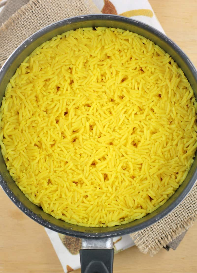 cooked termieric rice in a pot