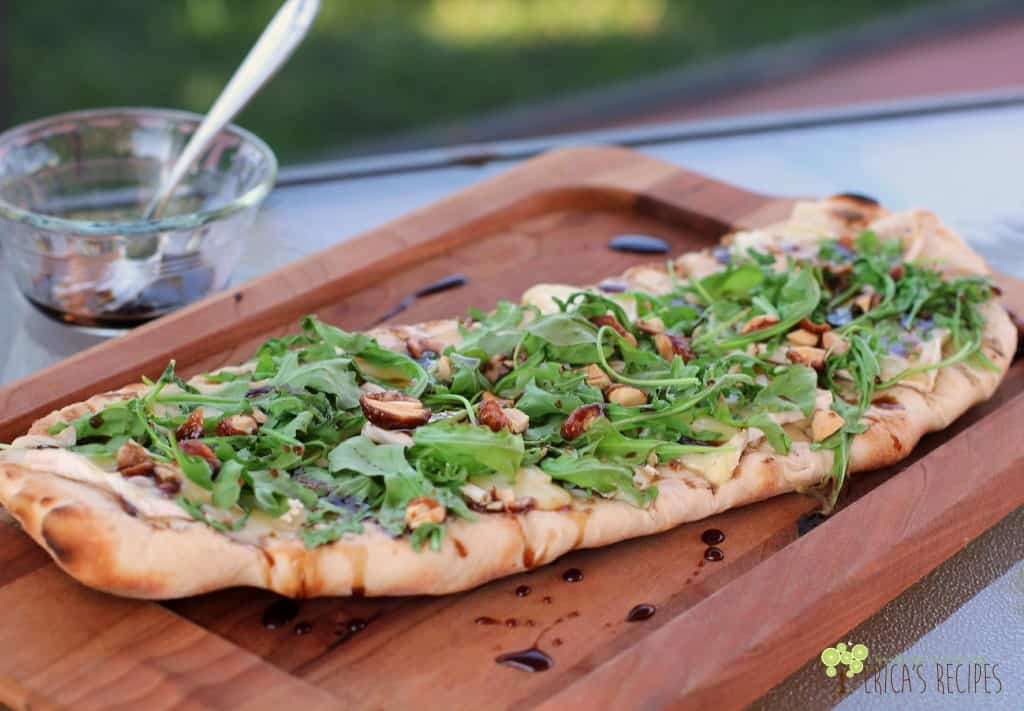 Grilled Flatbread with Brie, Arugula, Candied Nuts, and Balsamic-Honey Drizzle