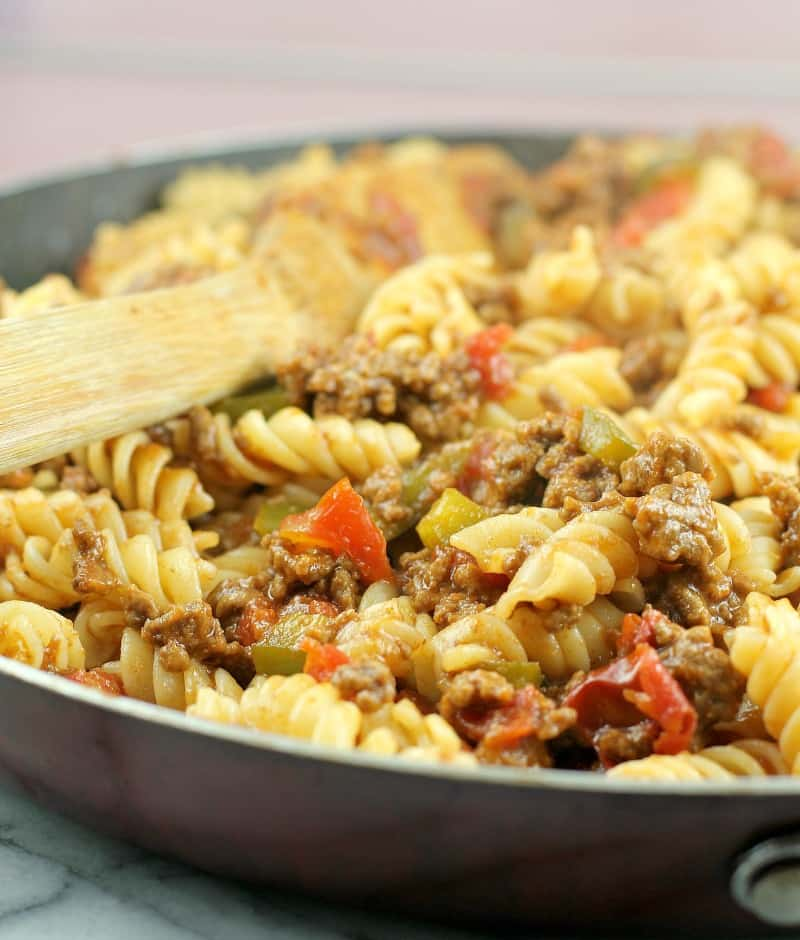 sloppy joe pasta in a skillet with a wooden spoon