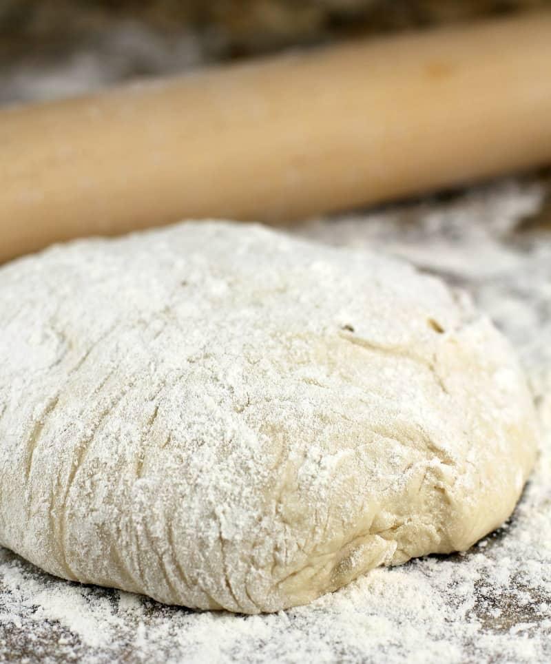 pizza dough on a flour surface
