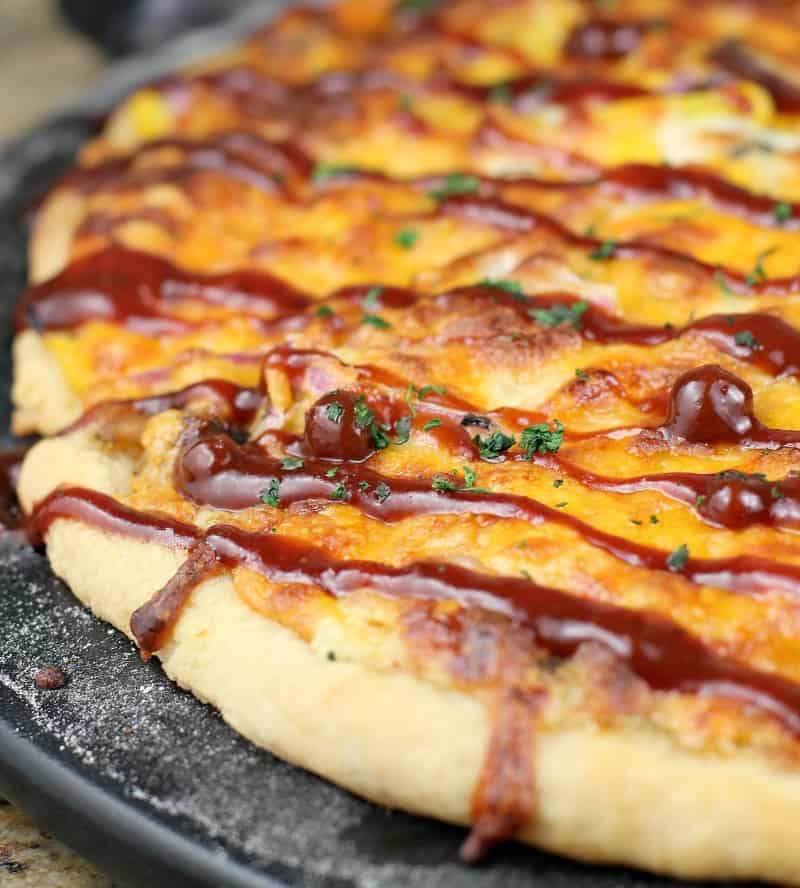 cooked pizza with bbq sauce drizzled over