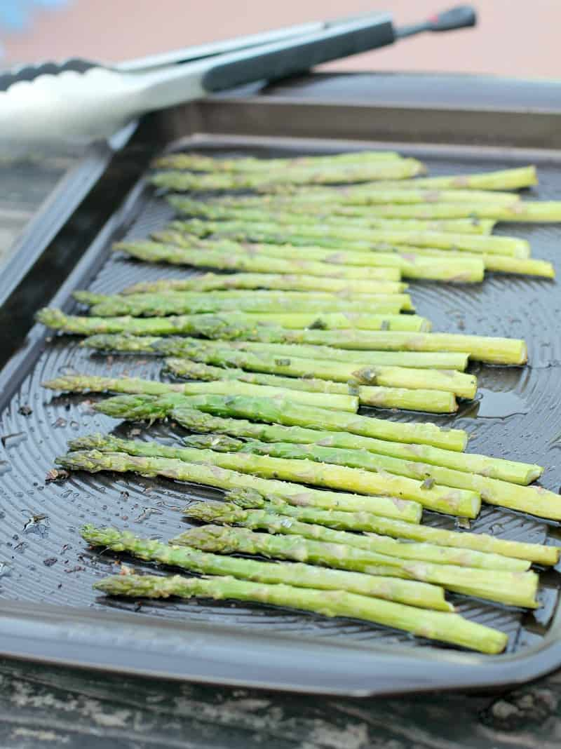 roast asparagus in dark rimmed bake sheet