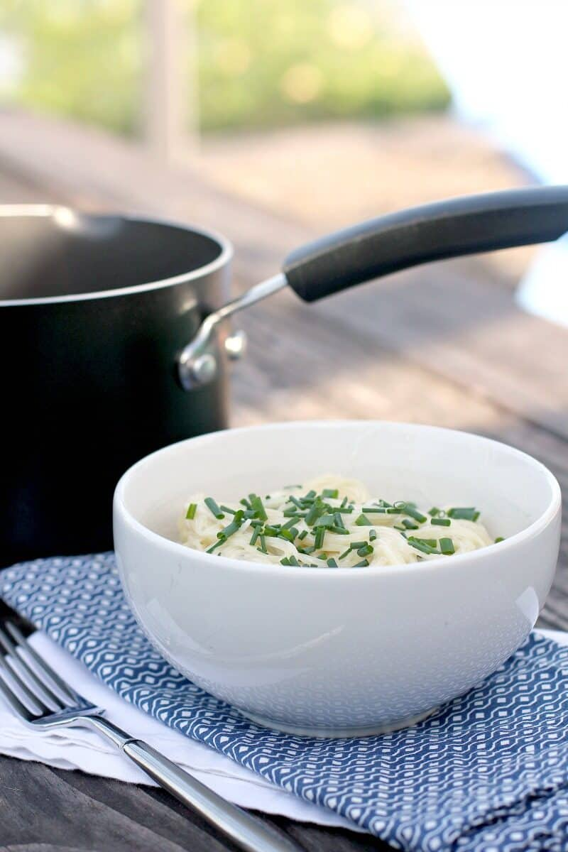 white bowl and black saucepan on picnic table