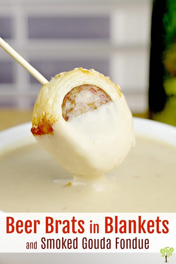 "Savory bratwurst, simmered in dark German lager, wrapped in puff pastry, and served with a rich and smooth Smoked Gouda Fondue. This phenomenal combination of flavors and completely new take on ""Pigs in Blankets"" will make any party, any occasion, absolutely perfect. #food #recipe #appetizer #partyfood #brats #beer #fondue #gouda #cheese"