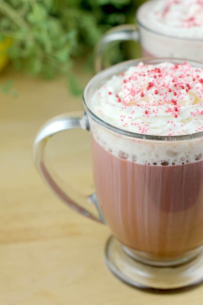 side view of glass mug with red velvet latte