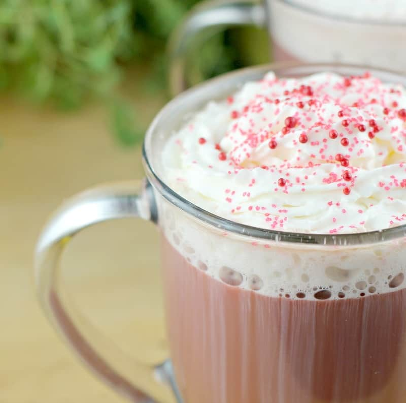 close view of whipped cream and sprinkles on red velvet coffee