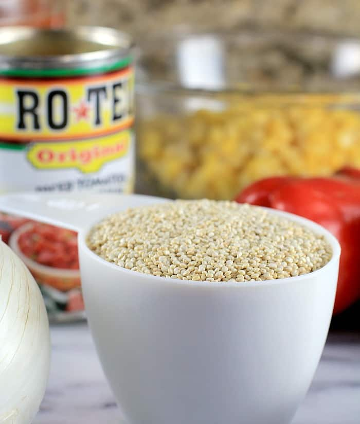 white measure cup with quinoa