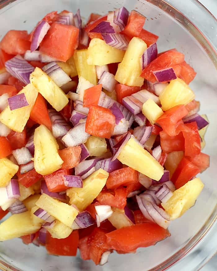 pineapple salsa in a clear glass bowl