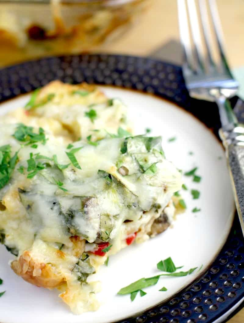 casserole on a plate with fork, topped with parsley