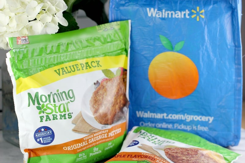 packaged Morningstar Breakfast patty value pack and Morningstar Farms maple sausage pack next to blue disposable Walmart shopping bag