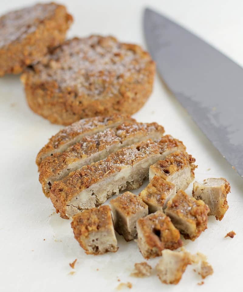 Morningstar sausage patties cut up on a cutting board