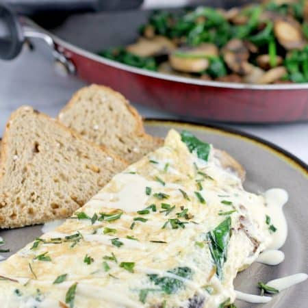 Healthy and satisfying, this egg white omelet with vegetarian sausage, spinach, and mushroom, will satisfy you breakfast, lunch or dinner. If you have goals this year and want to eat better to get there, this recipe is for you.