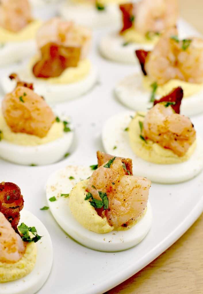 fully assembled shrimp deviled eggs on a white platter