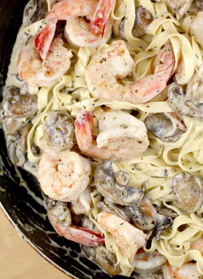 this shrimp linguine recipe, in the pan. shrimp and mushrooms in a cream sauce with pasta
