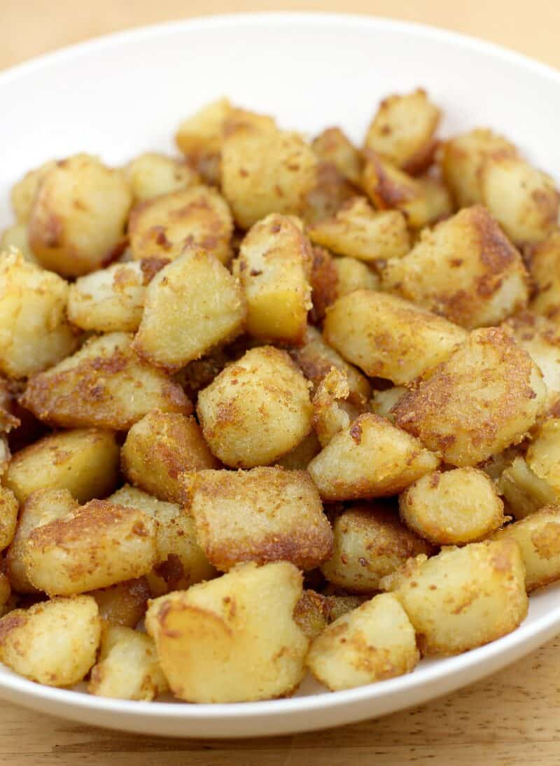 cooked potatoes in white bowl