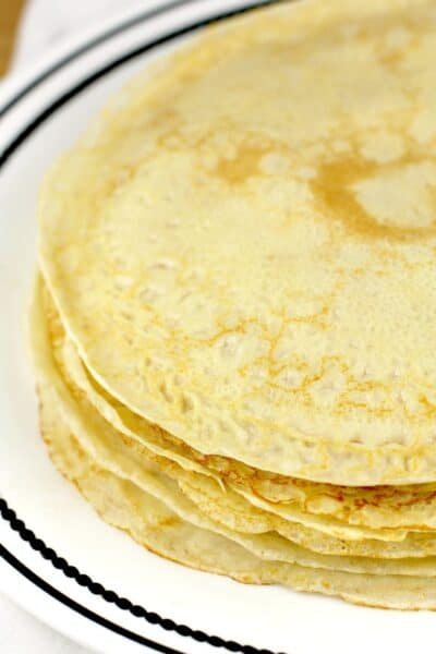 round crepes piled on white plate