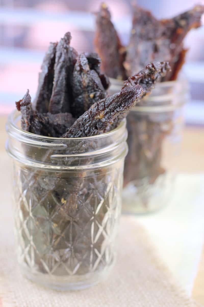 side view of terijaki beef jerky in glass jar