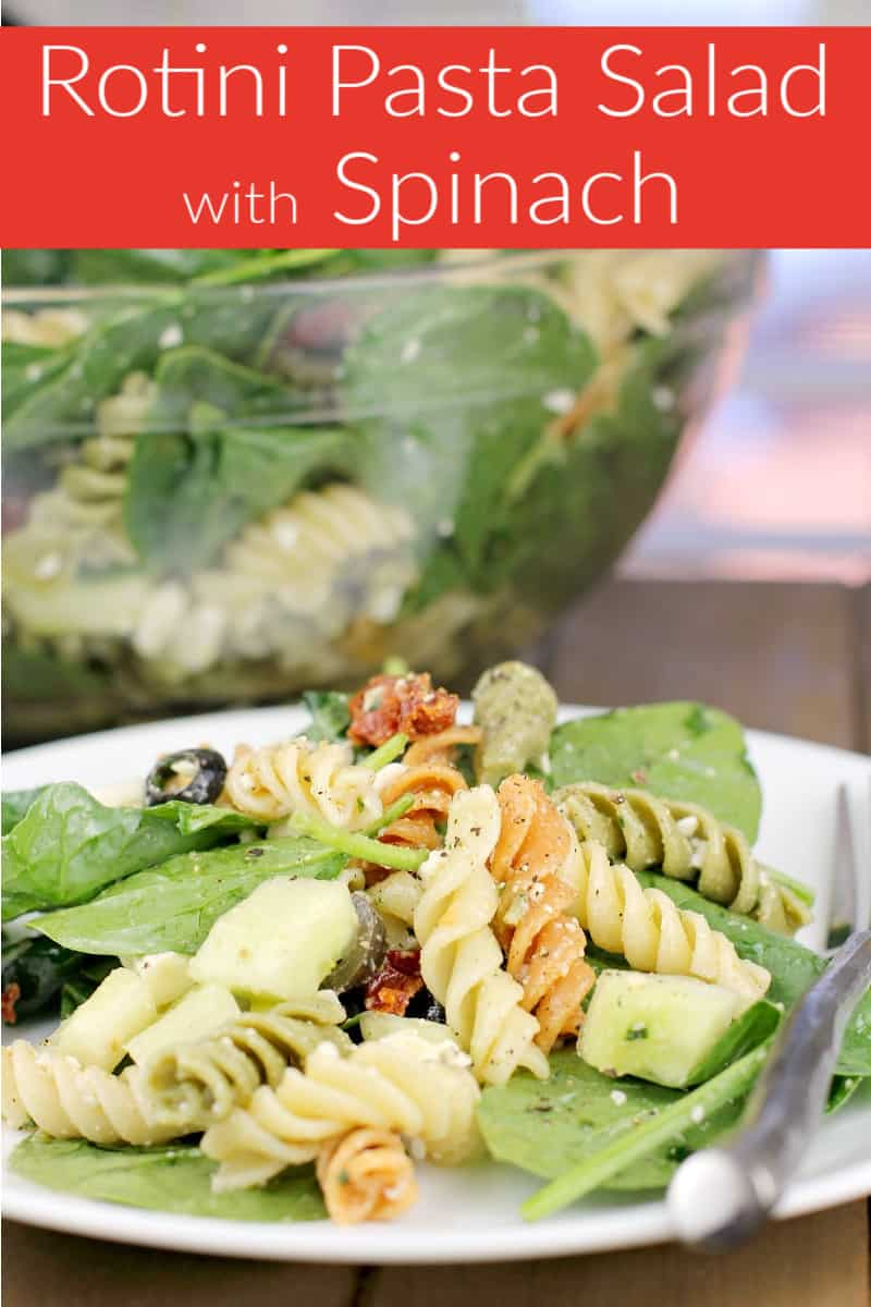 image for pinterest and social sharing with text overlay of recipe title Rotini Pasta Salad with Spinach