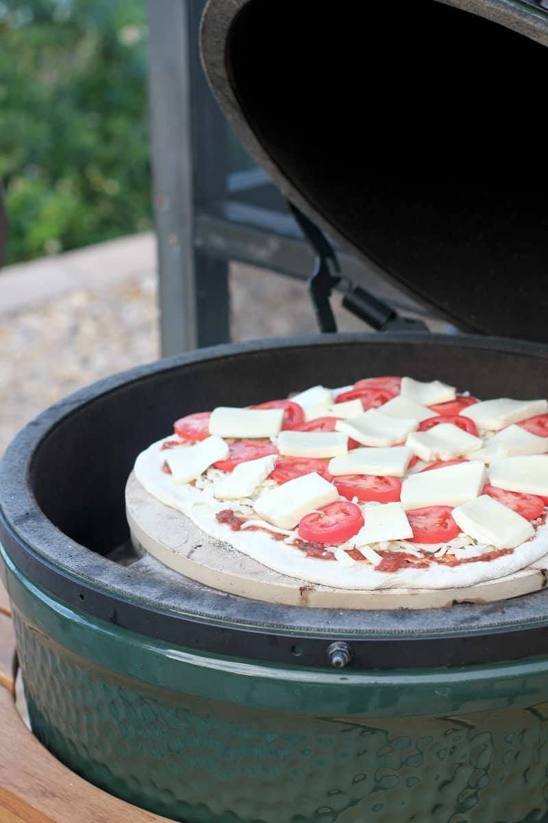 pizza cooking on the grill
