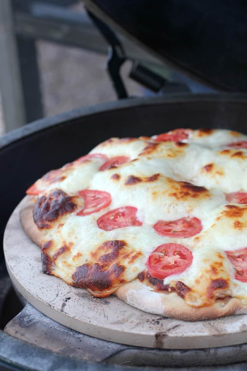cooked pizza on the grill