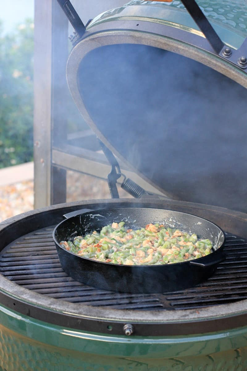 cast iron skillet on grill grate in big green egg