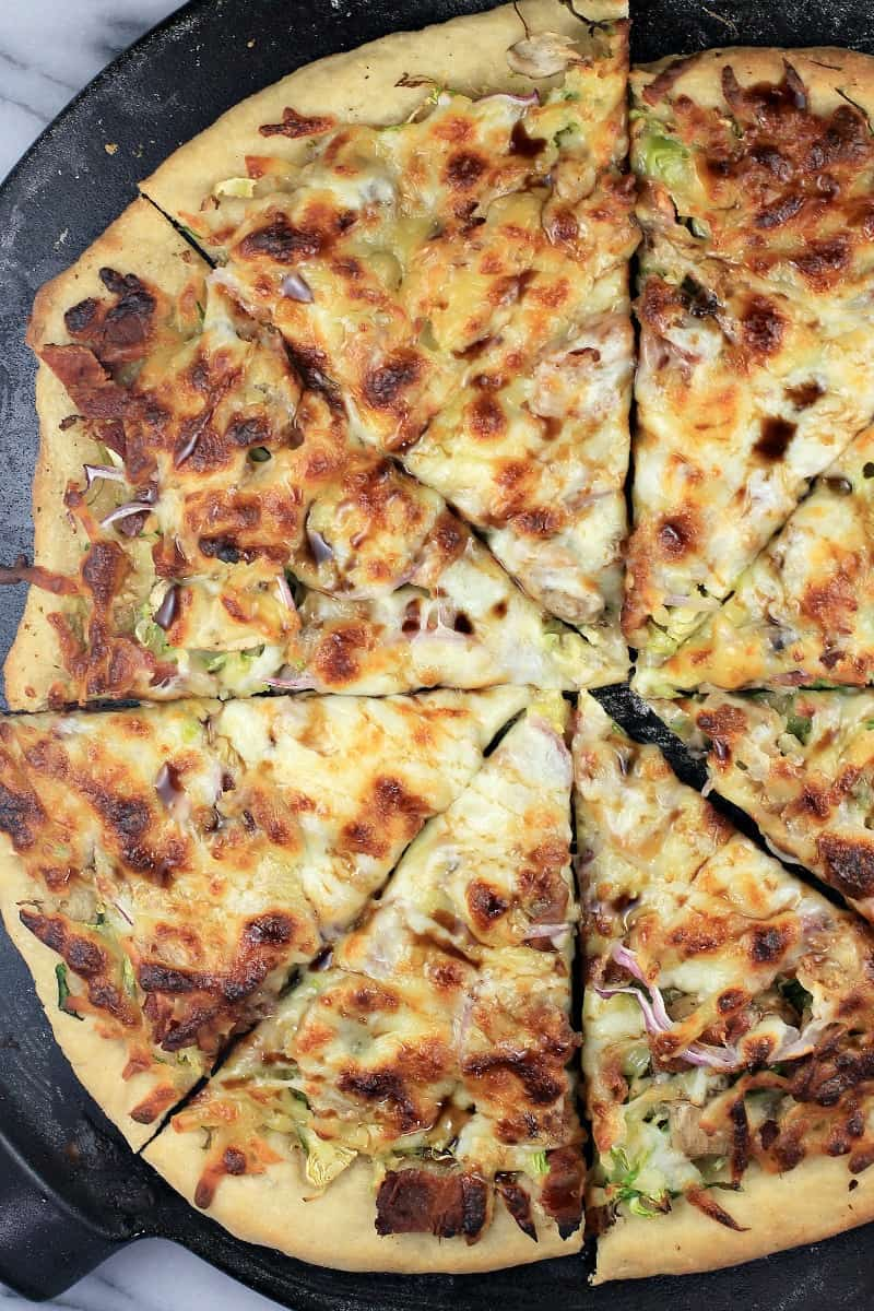 top down view of whole pizza, sliced