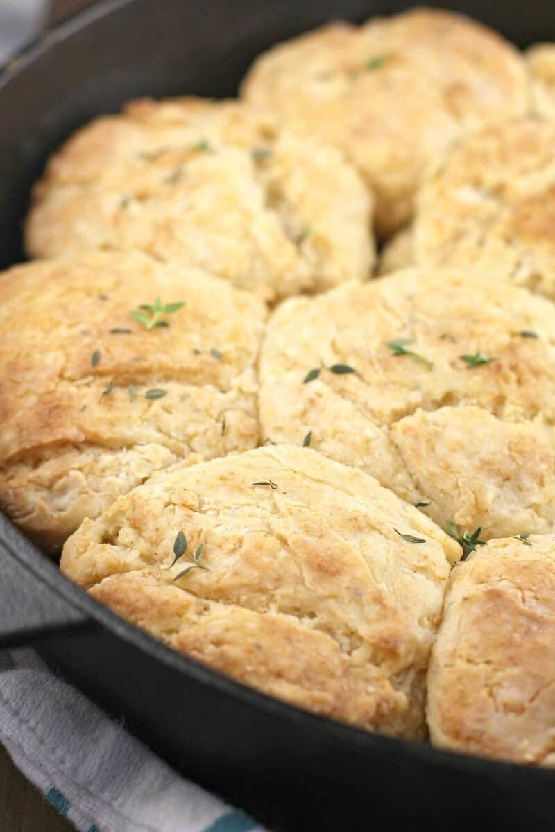 cooked biscuits in a pan with thyme sprinkled over