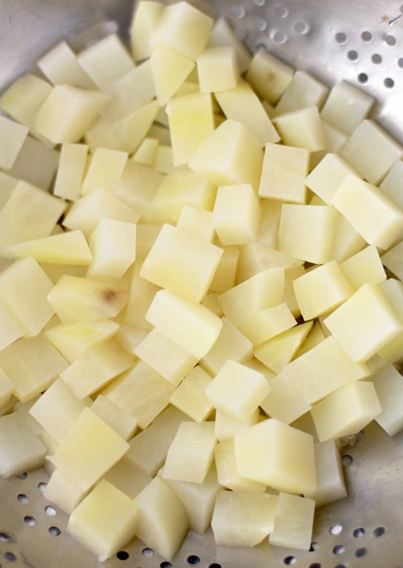 diced potato in collander
