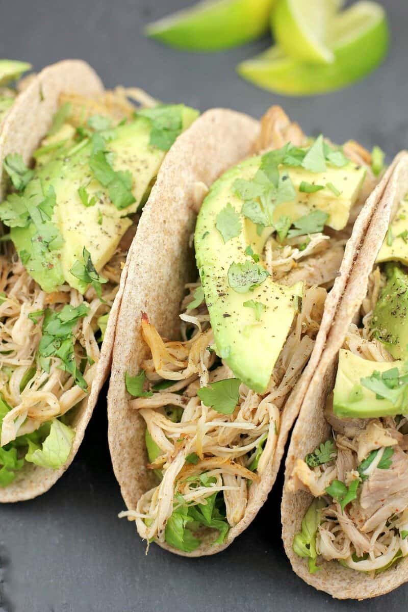 three tacos with chicken and avocado