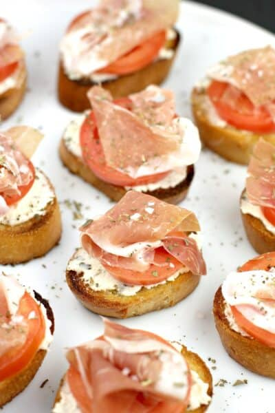 crostini appetizers presented on a white dish
