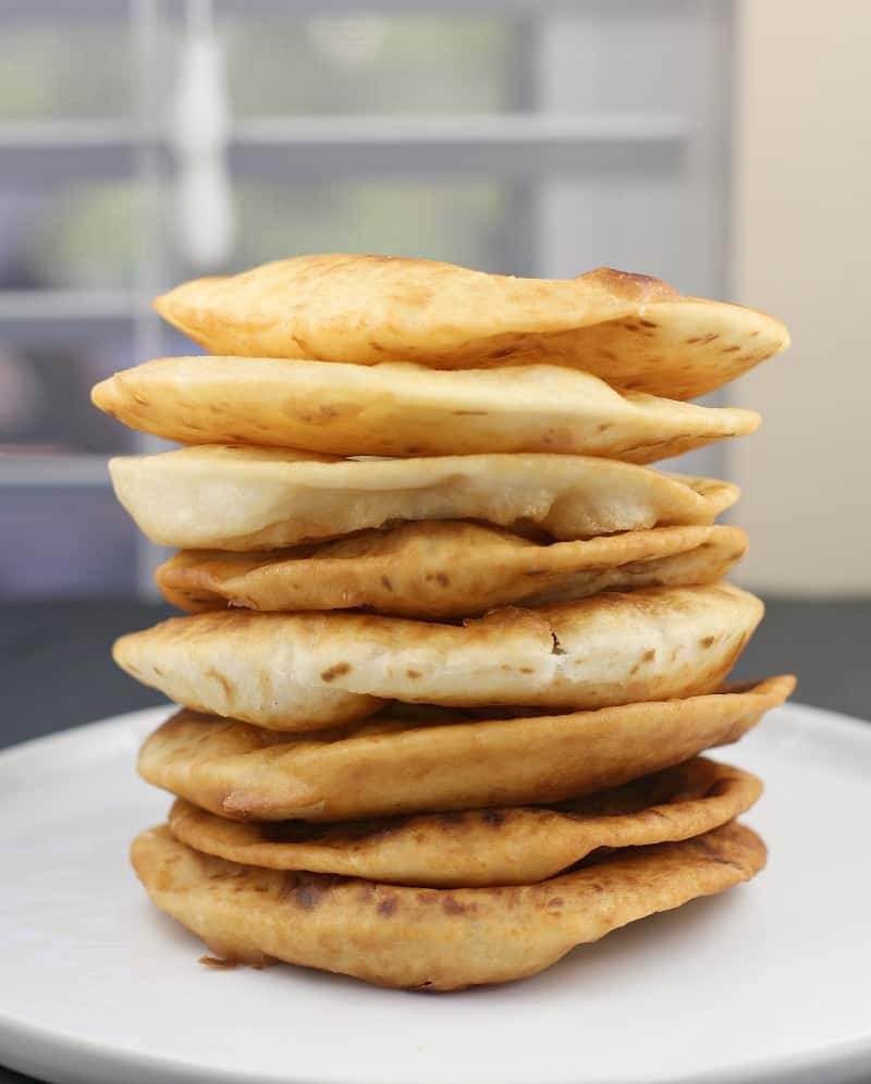 fried tortillas stack on a white plate