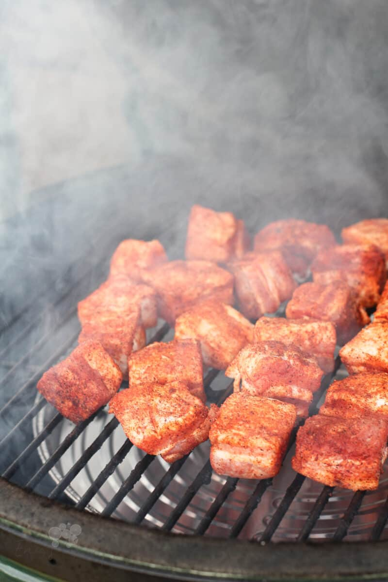 uncooked pork belly on grill grate