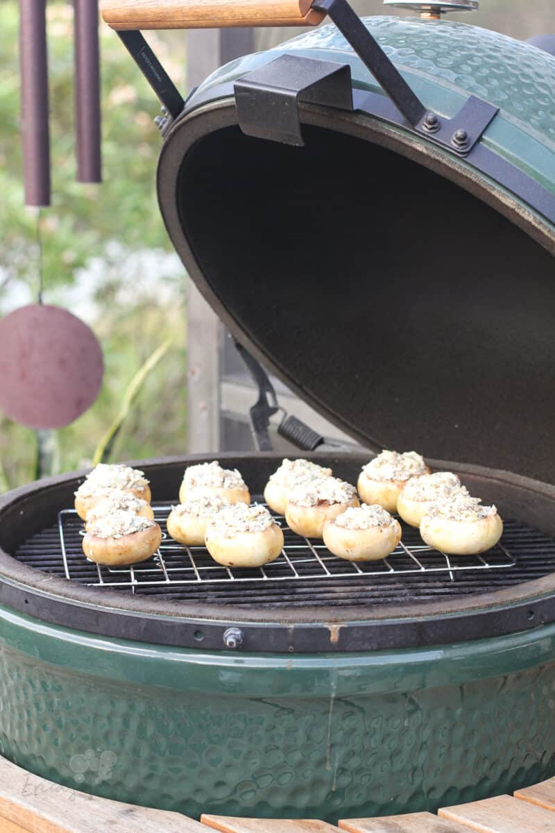 Big Green Egg open with mushrooms in on grill grate