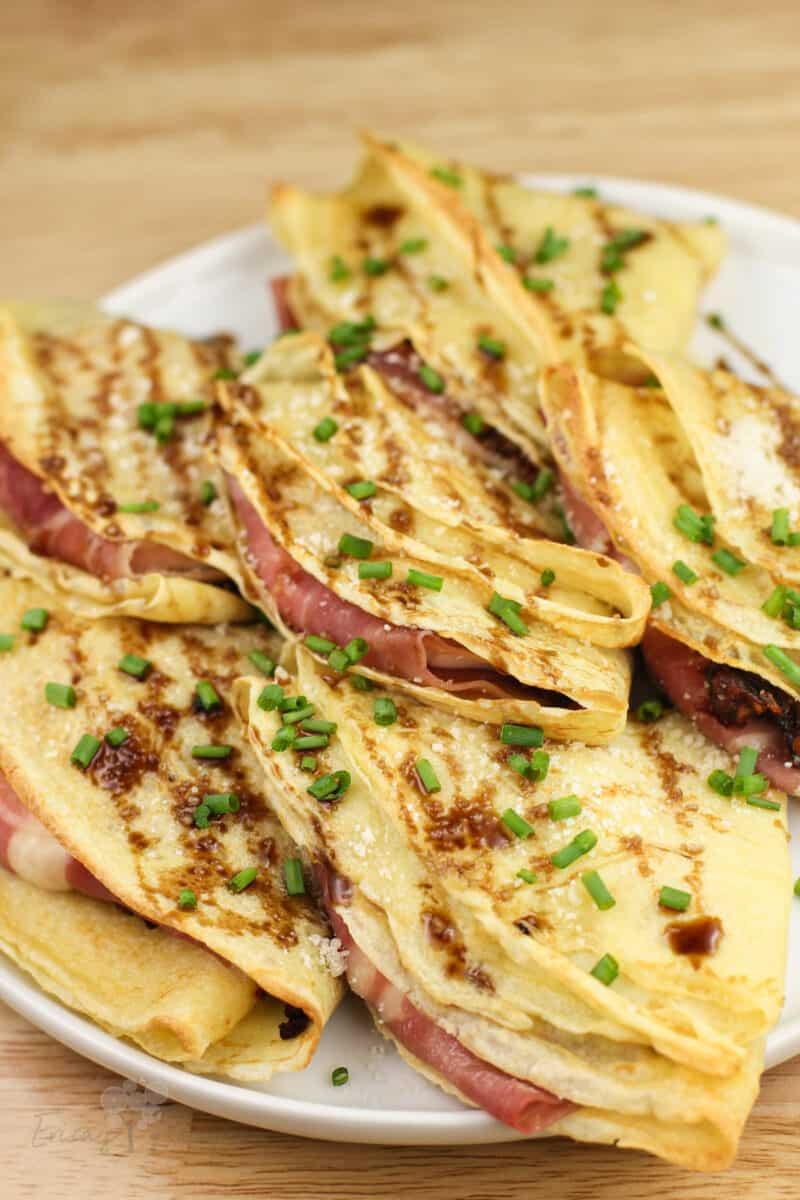 angled view of crespelle showing prosciutto inside
