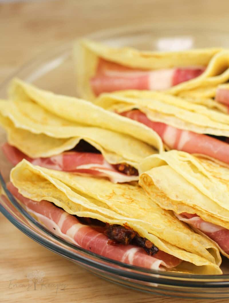 folded crepes in clear glass plate